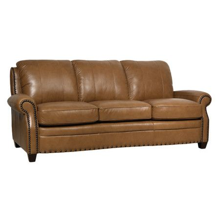 Leather Sofa Showcasing a rich wheat hue and brushed black nailhead trim this Italian leather sofa makes