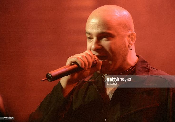 David Draiman (R) of Disturbed performs in support of the bands' Indestructible release at the San Jose State Event Center. Description from gettyimages.com. I searched for this on bing.com/images