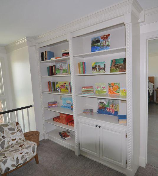 Custom built in bookshelf with storage. White bookshelf