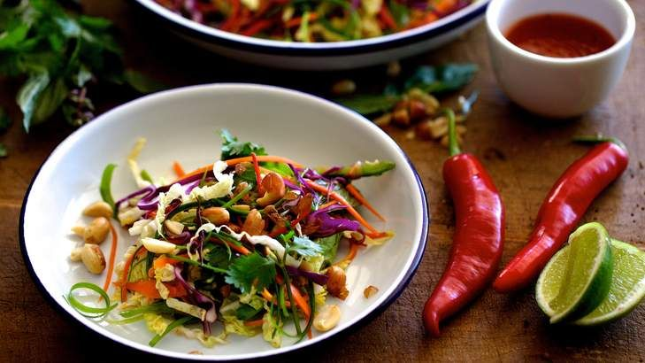 This crisp and crunchy coleslaw uses the pale, softer wong nga bak (wong bok/wombok/Chinese cabbage) and a hot, sweet-and-sour Asian dressing instead of the traditional raw green cabbage and mayonnaise.  Toss the salad just before eating or the cabbage will soften too much.