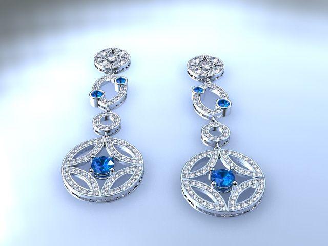 Pendientes de oro, zafiros y brillantes.18 k golden earrings with diamonds and sapphires.Ana G.Näs