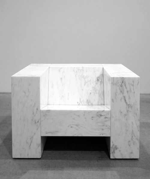 .Chair in Carrara marble.