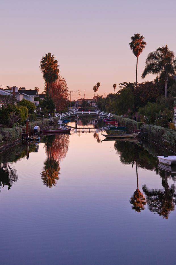 Just a few steps from the beach, you'll find the famous Venice Canals. Inspired by Venice, Italy, this neighborhood consists of several blocks of canals that run between multi-million dollar homes. It's a beautiful and peaceful place where you can escape the craziness of Venice in just a few minutes. Visitors can walk along the canals in the area located within South Venice Blvd., Pacific, Ocean Ave. and Washington Blvd. #venicebeach #canals #historical #water #houses #neighborhood #movies