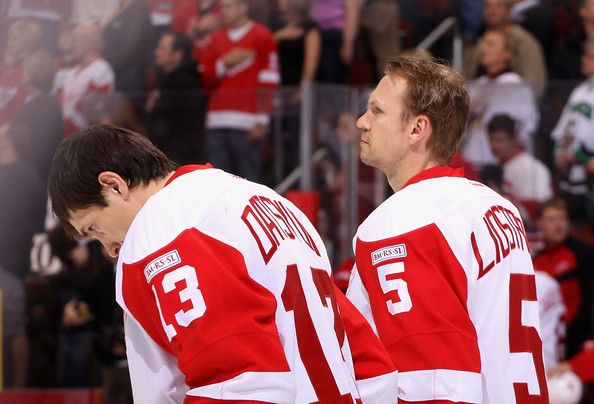 Pavel Datsyuk (13) and Nicklas Lidstrom (5) stand as the National Anthem of America plays.  (Red Wings VS Coyotes)  Nick always stood at attention until the anthem was over - no fidgeting, no movement, just pure honorable respect.  What a man.