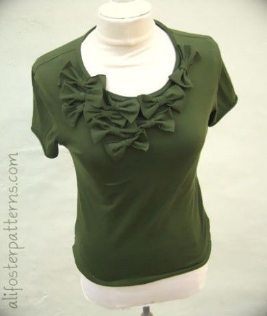 cut the sleeves off of a long-sleeved t-shirt and make bows to