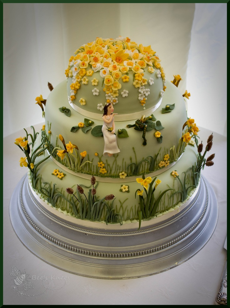 Spring wedding cake, daffodil and water plant theme. Bride and groom live on the river in a houseboat...