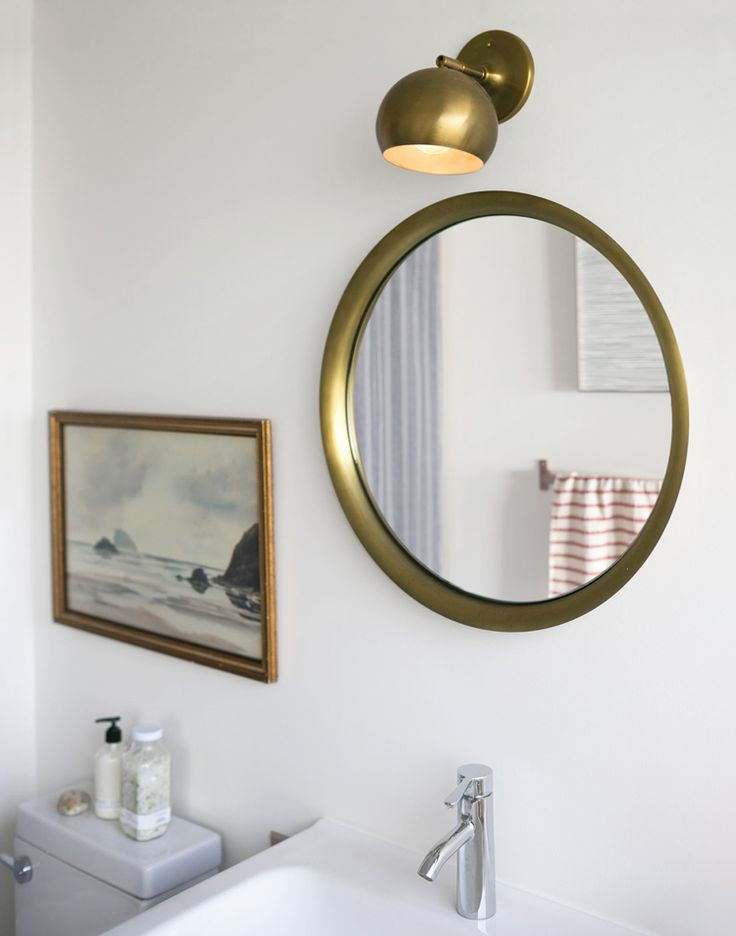 brass round bathroom mirror via @citysage