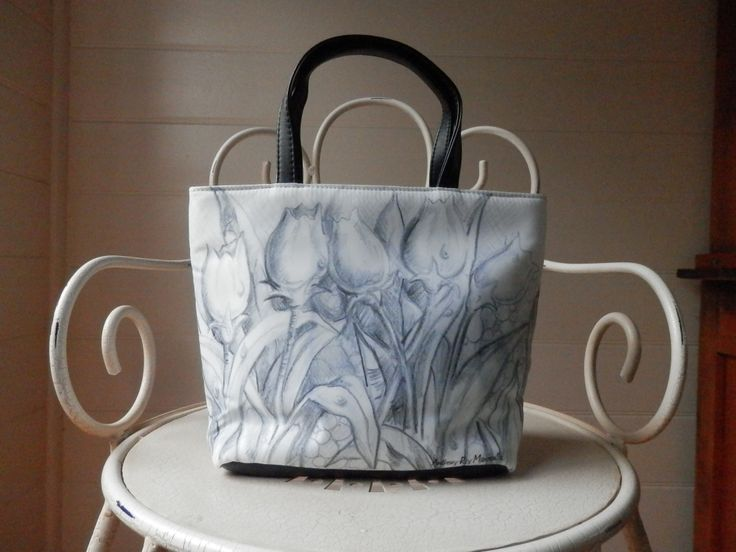 "This beautiful ""Petite"" bag is made from 100% polyester for easy cleaning."