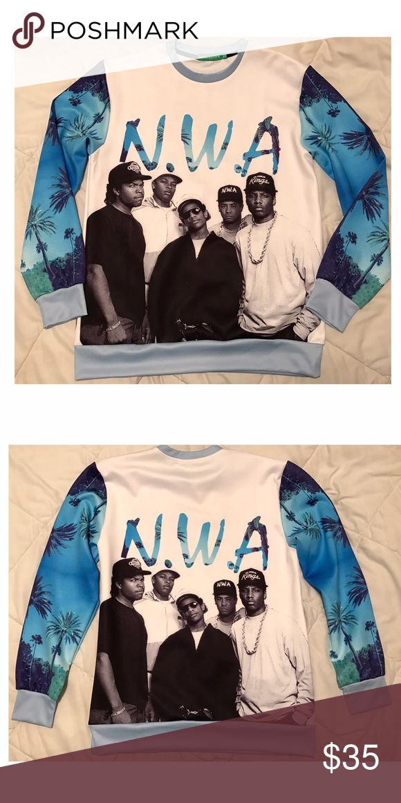 NWA Ice Cube Dr Dre Eazy E Women's Sweater top This is an awesome looking NWA women's Sweater top. I only wore it once to a west coast Ice Cube concert. Great compliments. Size tag says XL but runs small and will fit a perfect Large. Will also look great if you are smaller in size a want the oversized sweater look 😉👍🏻. Taking reasonable offers using counter offer button Sweaters