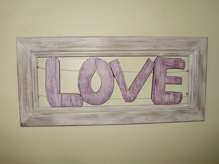 The word love suspended inside a frame