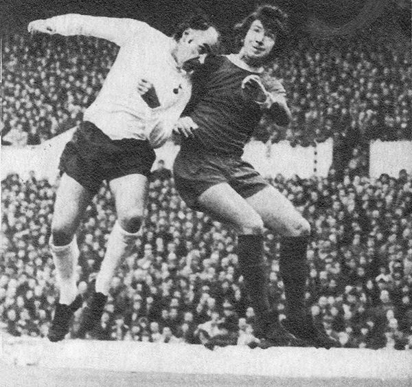 25th April 1973. Tottenham Hotspur striker Alan Gilzean challenged by Liverpool full back Chris Lawler in the UEFA Cup Semi Final 2nd Leg, at White Hart Lane.