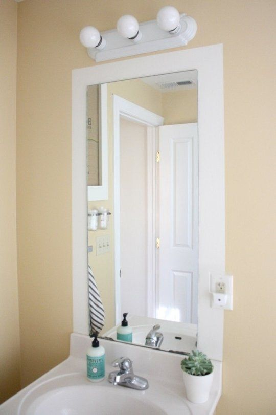 Paint a stripe around a frameless mirror - instant frame!  25 Small Bathroom Ideas You Can DIY | Apartment Therapy