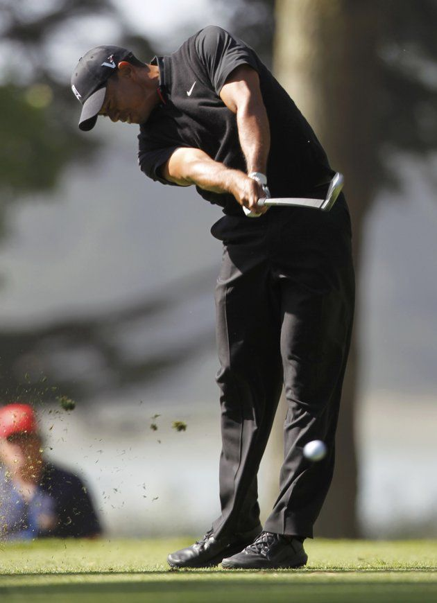 Tiger Woods of the U.S. tees off on the 14th hole during the second round of the 2012 U.S. Open golf tournament on the Lake Course at the Olympic Club in San Francisco