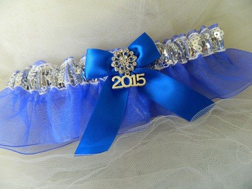 An elegant prom garter silver sequences and royal blue organza- This garter set is embellished with satin bow and 2015 charm , centered with a sparkling rhinestone. ~~~ ~~My wedding garter are made-t