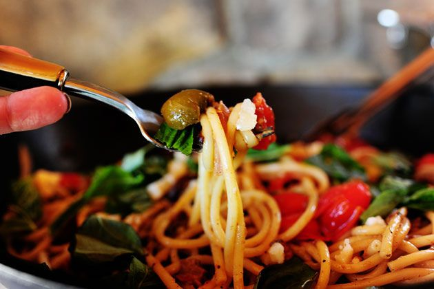 Pioneer Woman recipe for Pasta Puttanesca.   The recipe calls for bucatini (or spaghetti), red onion, grape tomatoes, garlic, anchovies, pitted yummy olives, olive oil, chicken broth or wine, basil, and Parmesan cheese.  I can't wait to try it.