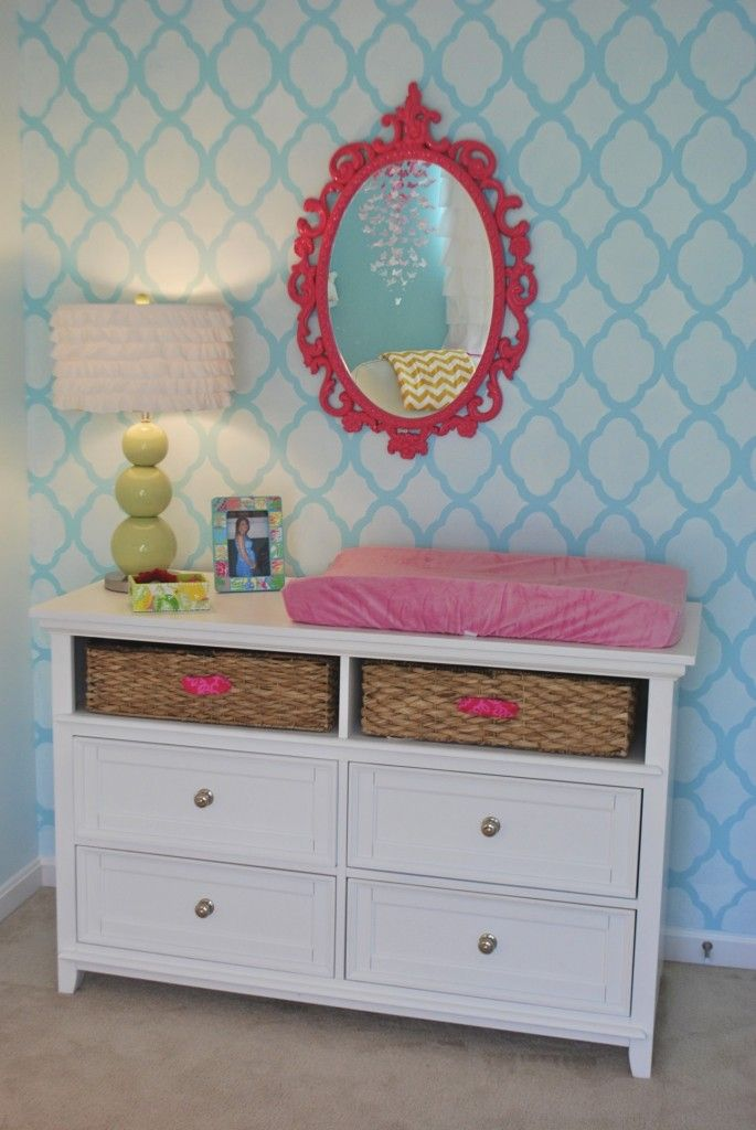Stenciling walls gives the appearance of #wallpaper without the permanence.   #stencil #hotpink #nursery #turquoise #trellis