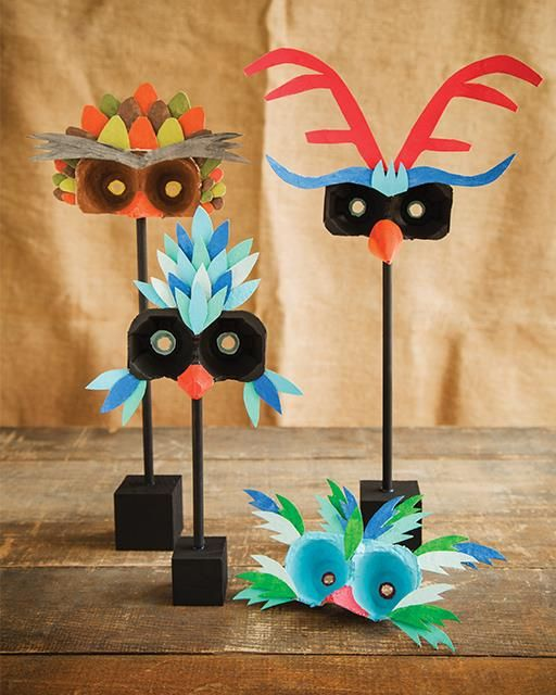 Egg Carton Bird Masks | Use something as simple and everyday as egg cartons to create these beautiful masks. They're like a menagerie of exotic birds.
