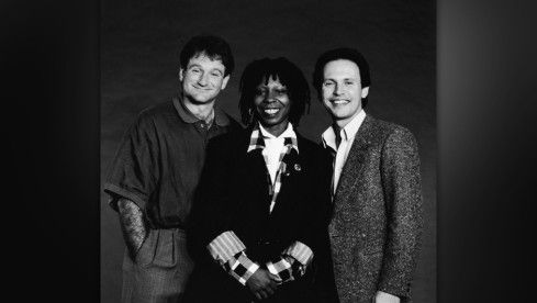 Studio portrait of American comedians and Robin Williams, Whoopi Goldberg and Billy Crystal, the hosts of the 'Co