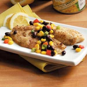 Tilapia with Corn Salsa Recipe -My family loves fish, and this super-fast and delicious dish is very popular at my house. Though it tastes like it takes a long time, it cooks in minutes under the broiler. We like it garnished with lemon wedges with couscous on the side.