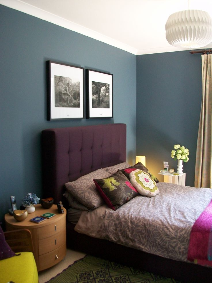 Dulux beautiful inky dark Blue on walls, paint is called: Steel symphony BLUE 1.  purple bedroom bed headboard AVA by LivingitUp, great bed company. Habitat pair of Frames with Pirelli calendars inside. Glamourous home:)