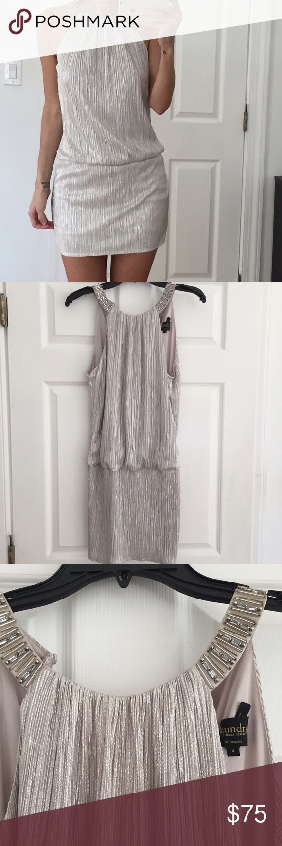 LAUNDRY SHELLI SEGAL LOS ANGELES - silver dress LAUNDRY SHELLI SEGAL LOS ANGELES - silver dress. Midi dress with jeweled round neck and back zipper. This dress has never been worn. NWT. Purchased from Bloomingdales for an event and I never ended up going. Offers welcome. Laundry by Shelli Segal Dresses Midi