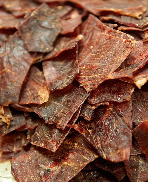 Sriracha Beef Jerky Recipe (This beef jerky recipe has an enticing spicy salty umami thing happening thanks to a splash each of Sriracha and soy sauce.)