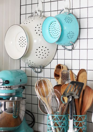 For a quick storage fix, stick some adhesive command hooks on the wall and hang bulkier items.