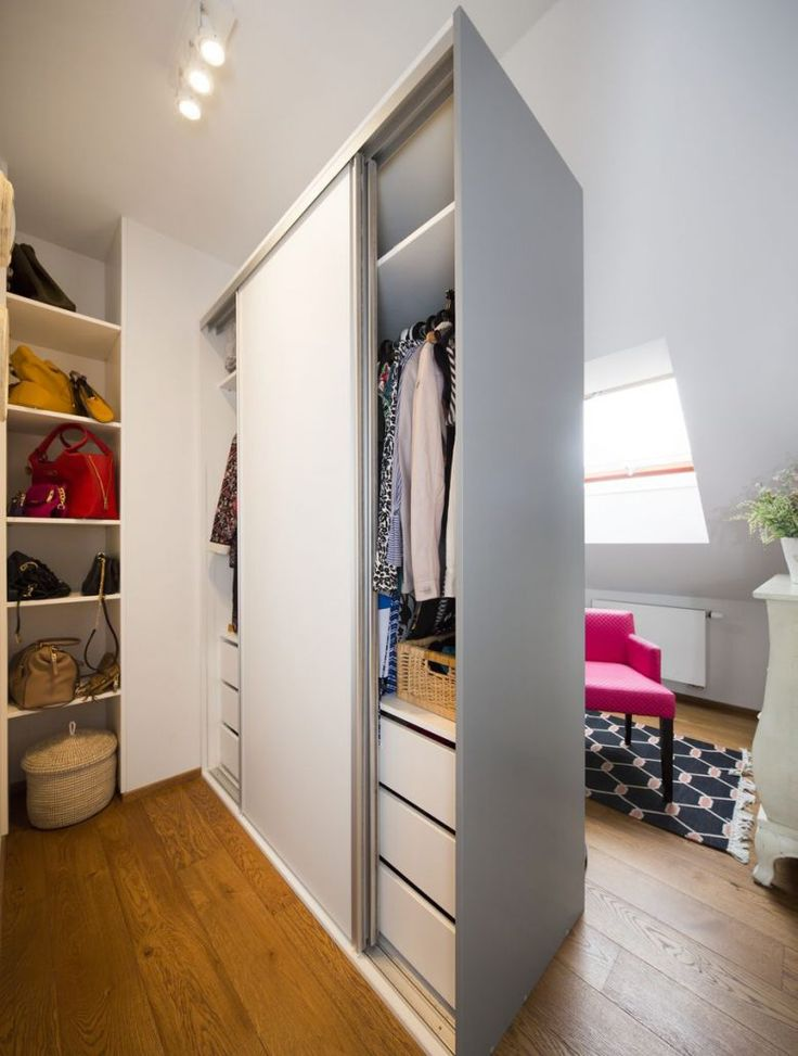 The dressing room features a big white wardrobe and a pink fuchsia Home Spirit armchair. #interior #design #dressingroom #closet