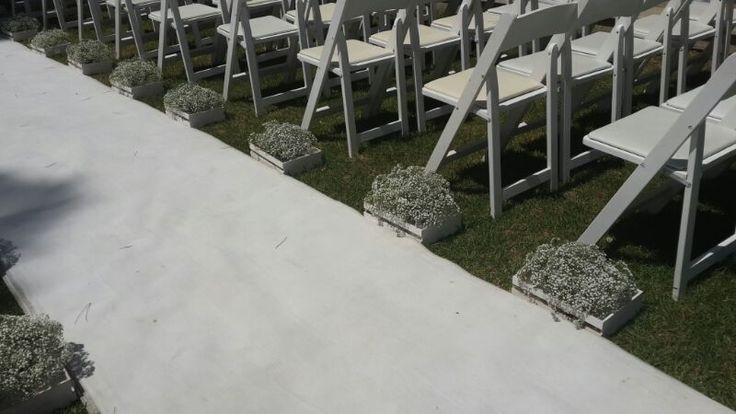 Forest themed wedding - White isle runner with wooden crates filled with baby's breath.