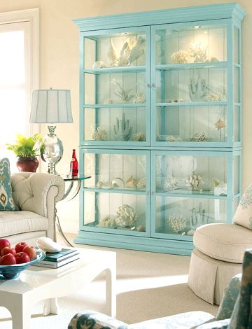 Aqua shelves filled with coral - love it!  And love the red pops of color too. Not my decor but how HOT is this???