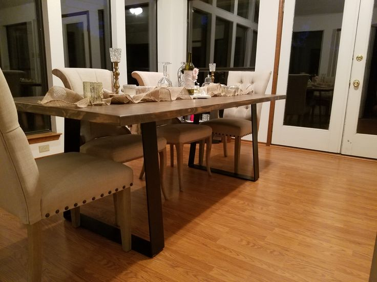 Flat Iron Dining Table. Weathered stain finish on a solid walnut table top. Flat steel legs