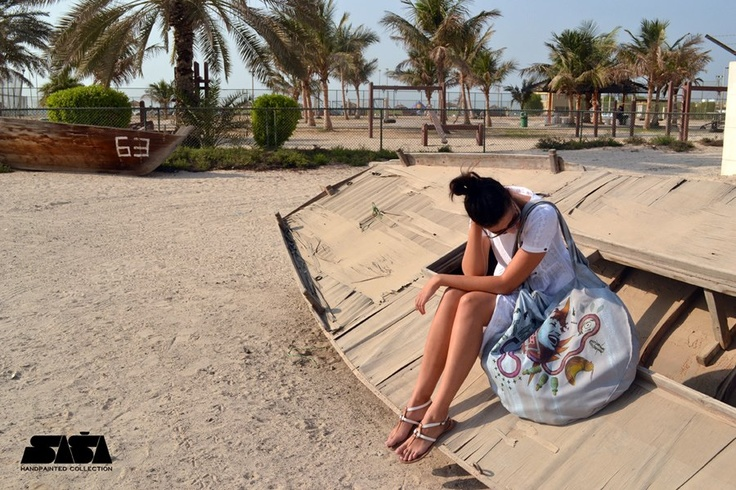 Hand painted bag resting in Dubai with Brankica. More at www.sasadesign.com