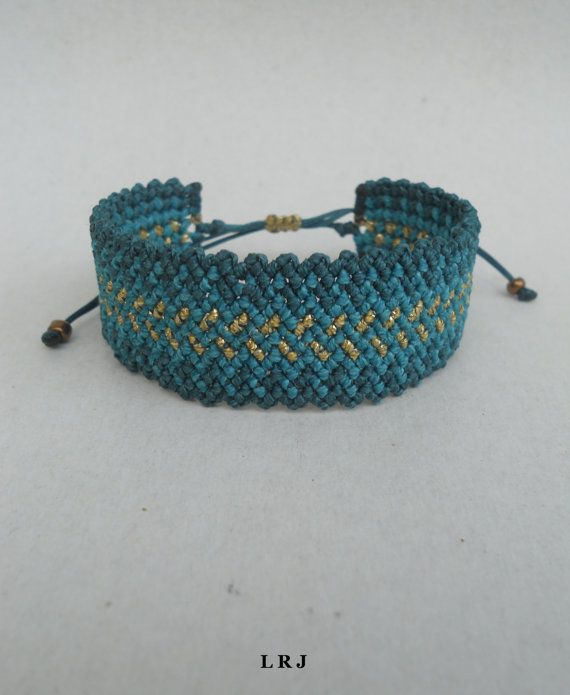This handmade macrame bracelet is made out of emerald,petrol and gold waxed string.  It is water resistant because waxed string is very durable