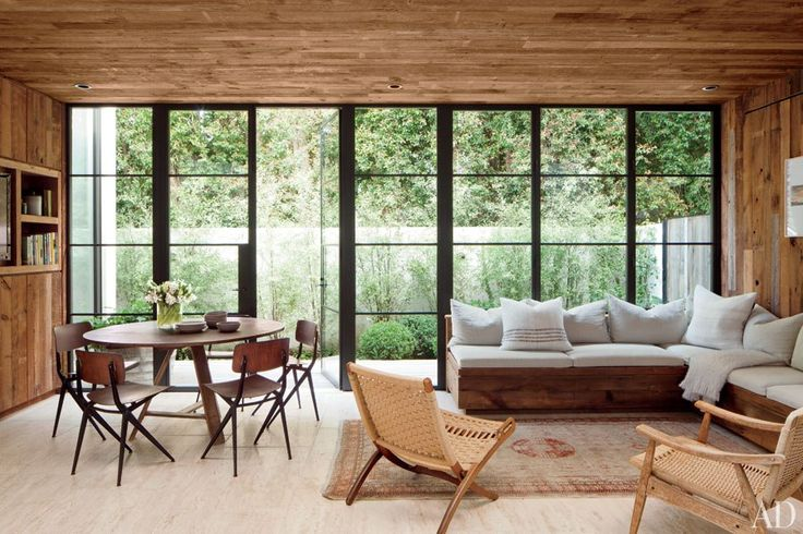 A living/dining area in fashion designer Jenni Kayne's laid-back L.A.  home is sheathed in salvaged siding.