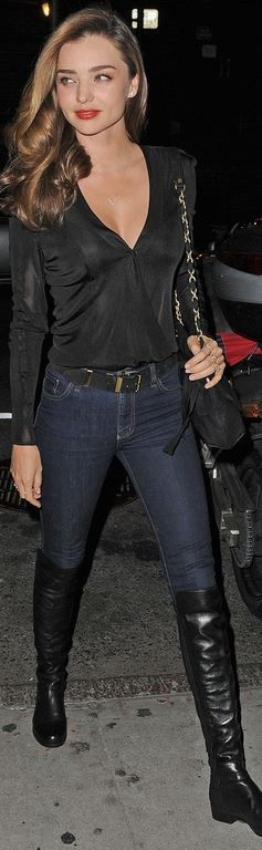 Who made  Miranda Kerr's blue skinny jeans, black leather over the knee boots, and blue skinny jeans that she wore in New York?