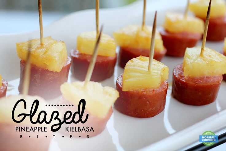 Glazed Pineapple Kielbasa Bites - This is one of the easiest and most delicious appetizers ever! I served them at a party, and everyone just gathered around this dish and was eating them one after another, ignoring all the other foods at the party. They're that good!