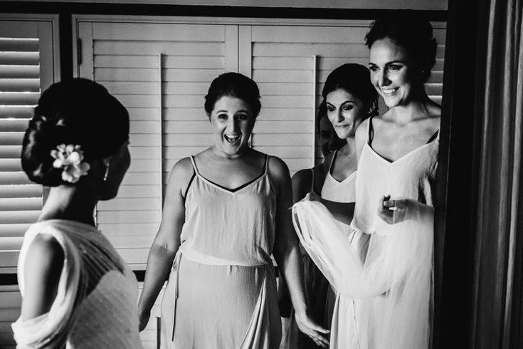 Bridesmaid's priceless reaction after seeing the bride perfectly dressed.