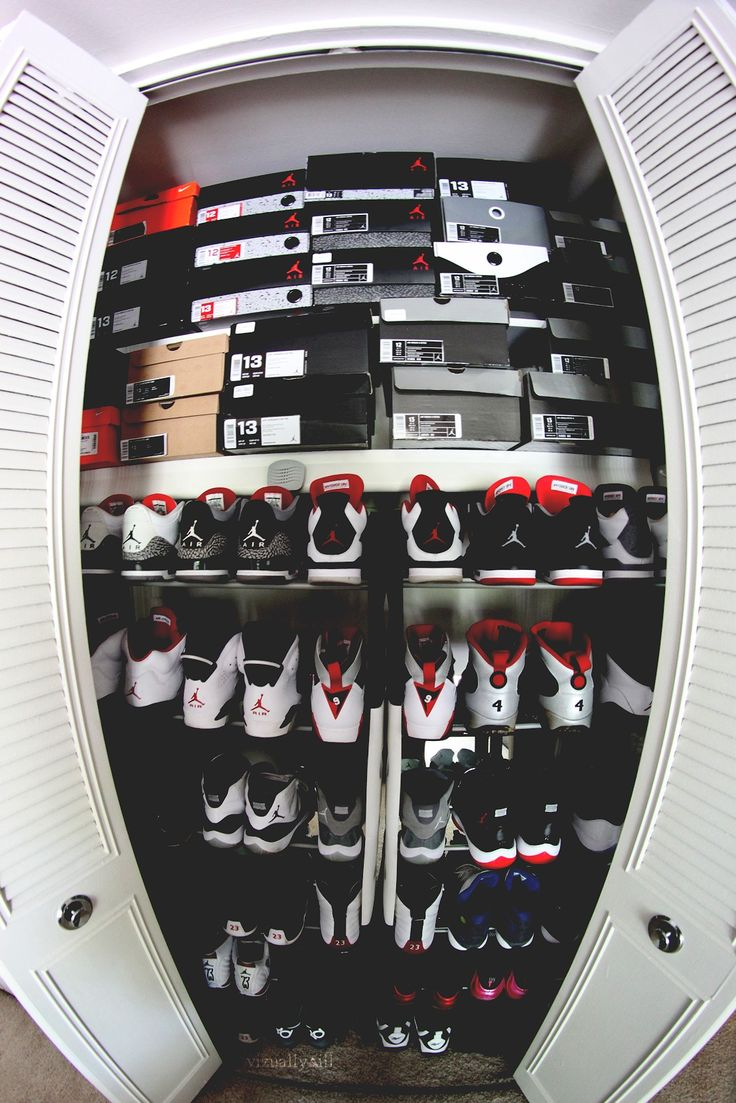 a collection of nike air jordan shoes. fly high with jordan who wouldnt want this in their room righ