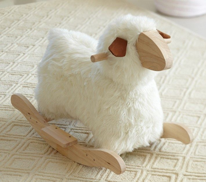Inspired by the tough-to-find Rocking Sheep by Danish designer Povl Kjer, this fuzzy rocking toy is huggable and easy on the eyes.  Pottery Barn | Dwell