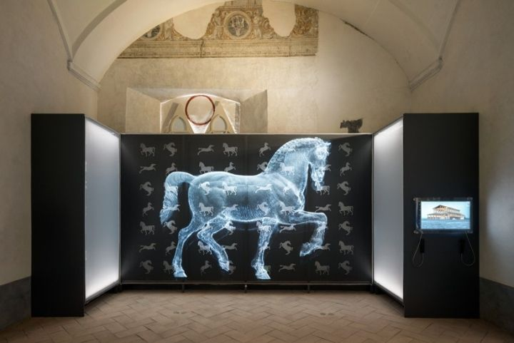 A large grid-like structure is used to display the drawings, as well as stands below showing books letters and notes. The contemporary nature of the installation, compliments the original pieces which date back to the fourteenth century.