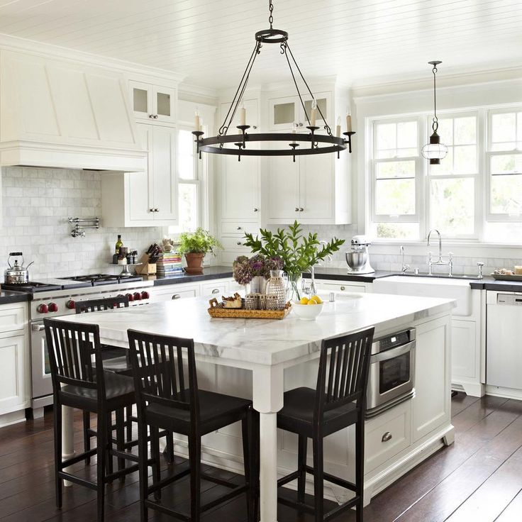Gray counter tops with white marble island counter top That island light!