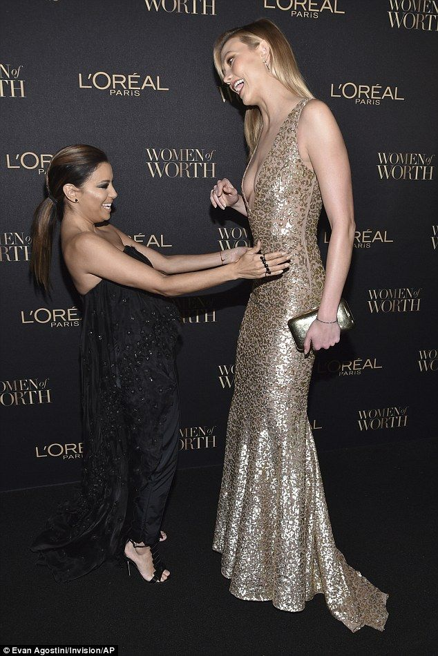 You're so tall!Karlie Kloss, who stands at 6ft2in towered over fellow attendee Eva Longoria, who is a foot shorter at 5ft2inat the L¿Oréal Women of Worth Awards in New York on Wednesday