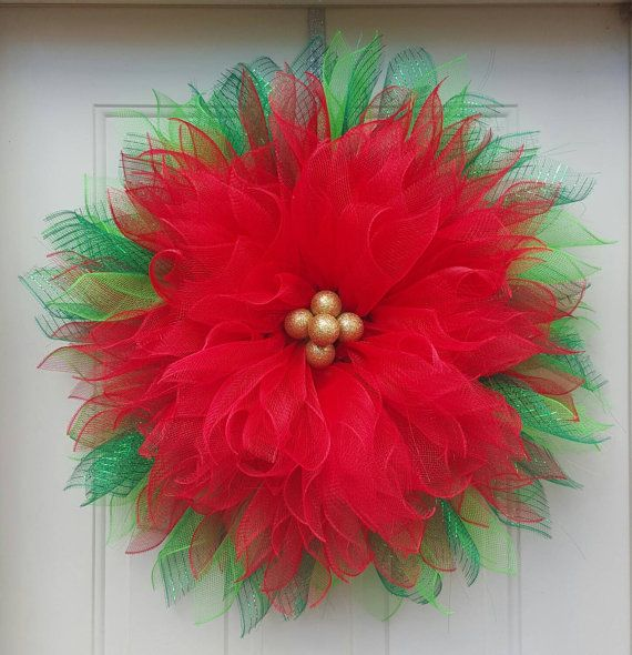 Poinsettia deco mesh wreath. Should be brought in when it rains.