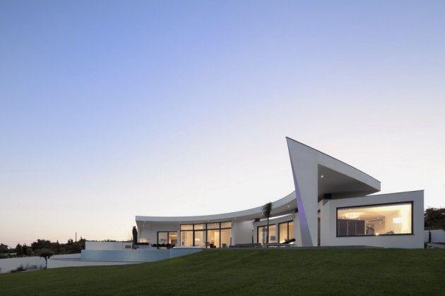 Portuguese architect Mario Martins has designed the Colunata House in Lagos, Portugal.