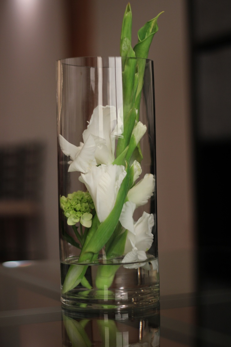 Simple modern placement of gladioulus in a vase not for Contemporary table centerpieces