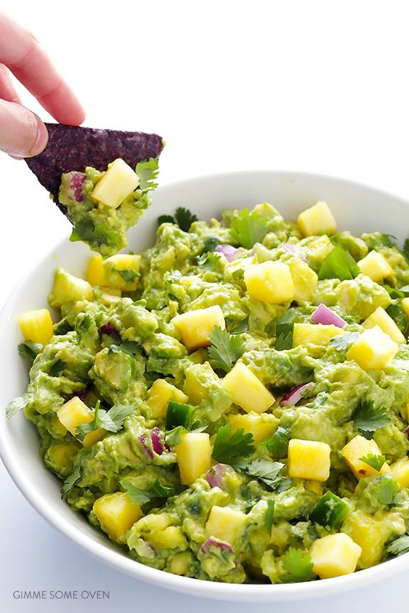 Pineapple Guacamole Recipe -- all of the goodness of this classic dip, sweetened up with some fresh pineapple!