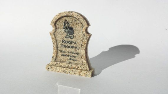 "This specific tombstones is for the classic Koopa Troopa, now having earned his wings has become a Para-Troopa in heaven. Epitaph reads: ""Well... He always wanted wings"" -Bowser Available at www.ChinookCrafts.Etsy.com"