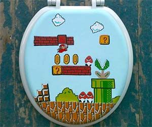 Super Mario Bros Toilet Seat  Decorate your bathroom with the greatest plumber you'll ever know with the Super Mario Bros toilet seat. This hand painted toilet seat depicts the classic Super Mario tearing it up in the nostalgic 1-1 level, and comes triple layered in polyurethane to protect the paint.  Buy It  $70.00