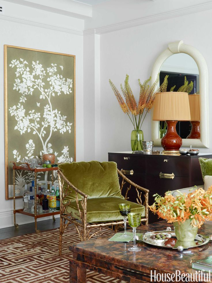 A hand-painted Gracie panel enhances a living room wall and serves as an…