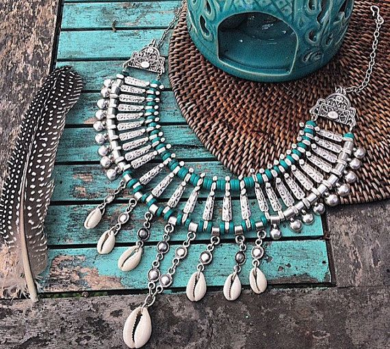Rider of the Storm Stunning Turquoise collar adorned with aztec printed Silver pewter, tasseled with cowrie shells. Finished with a multi loop chain